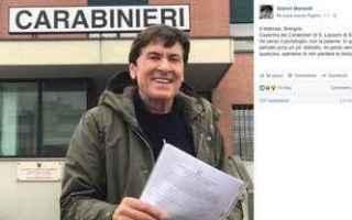Gossip: gianni morandi  carabinieri  portafoglio