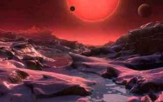 E a 40 anni luce da noi. Il cuore è la stella nana rossa Trappist-1, i pianeti hanno temperatura tr
